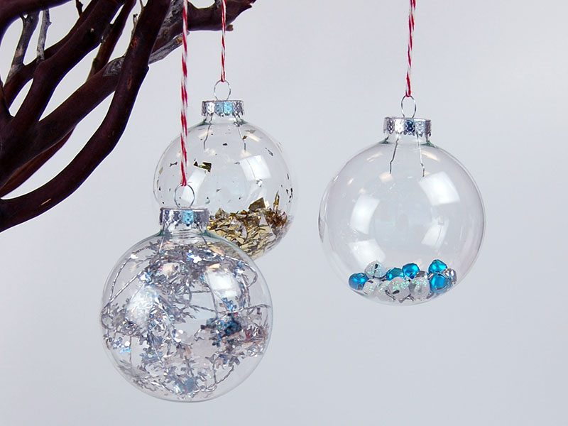 DIY: Fill clear ornaments with confetti, tinsel or jingle bells