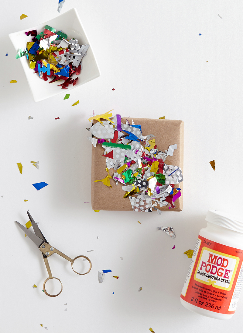 Confetti Glued To Plain Brown Wrapping Paper