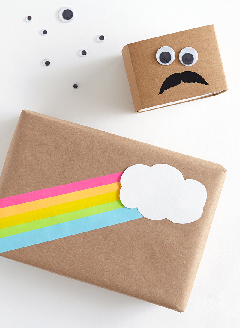 Rainbow cloud and googly eyed mustache face on Plain Brown Wrapping Paper