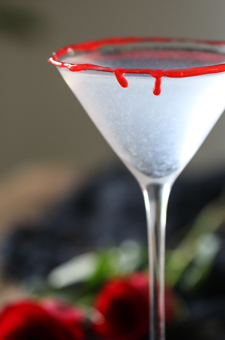 Blood rimmed Halloween cocktail glass and roses