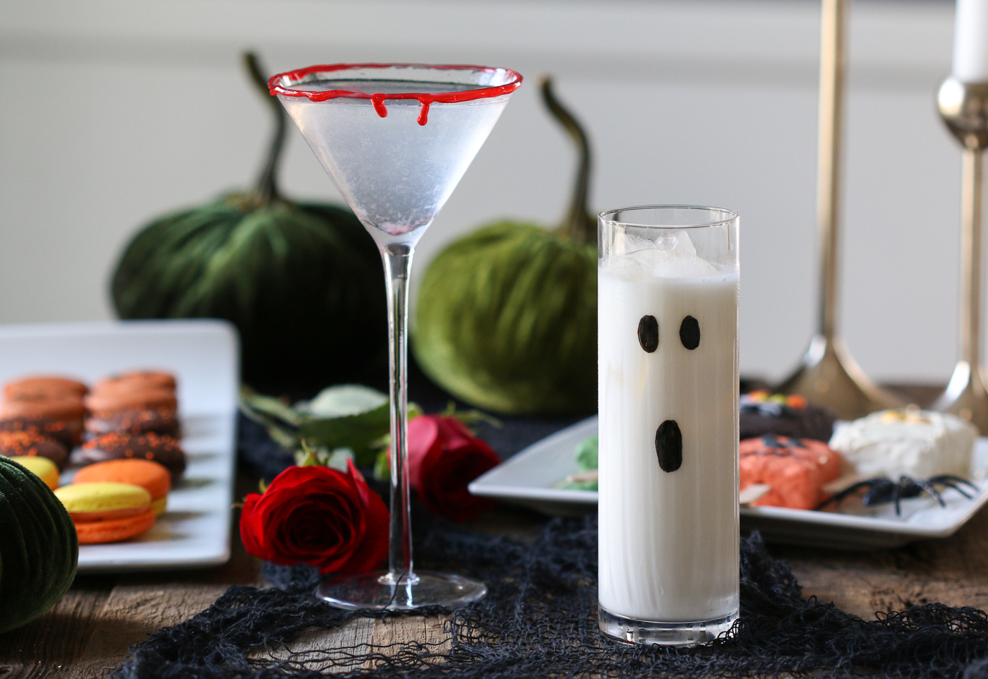 Halloween cocktails with macarons and roses