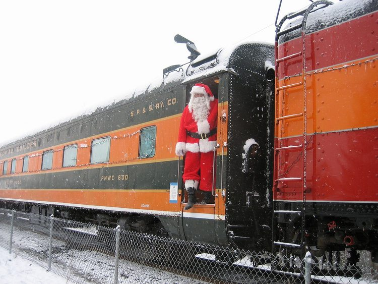 Santa boards a train