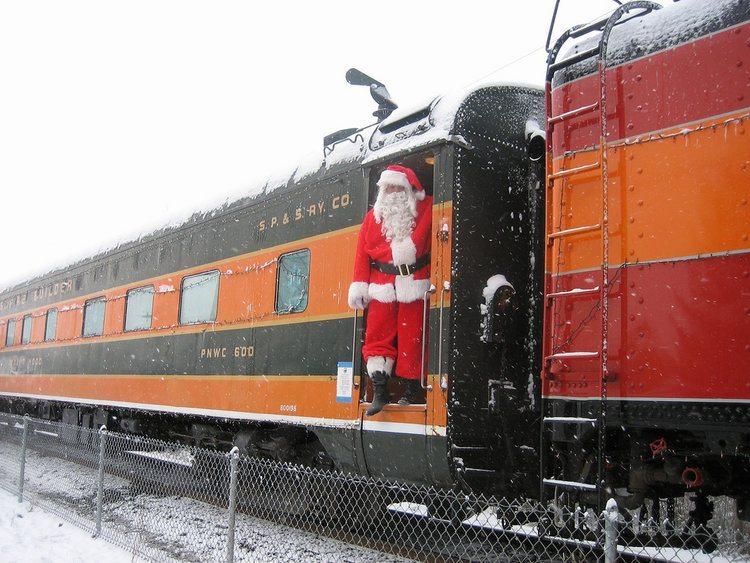 Santa boards a train