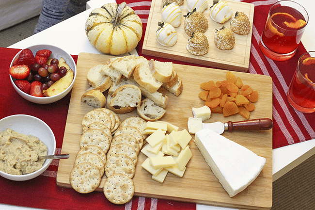 cheese and crackers platter with cranberry champagne cocktail