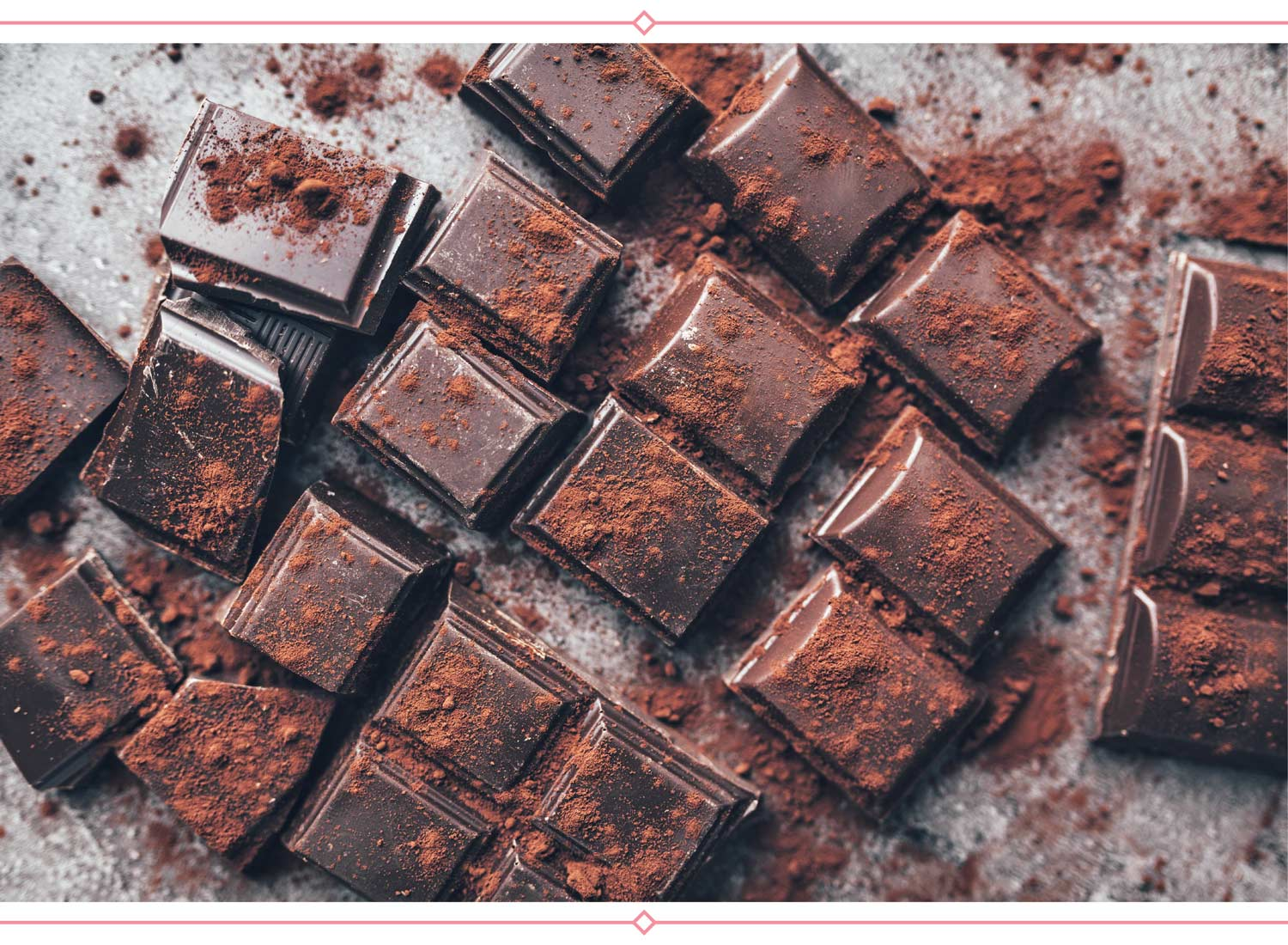 dark chocolate pieces with cocoa powder