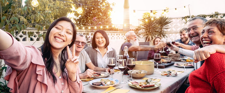 family smiling dinner