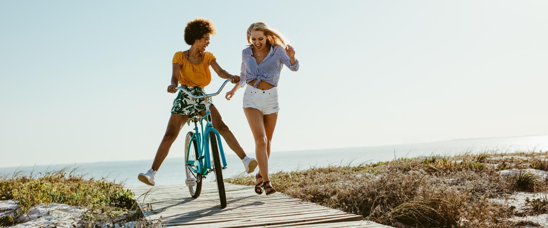 girl on bike and friend